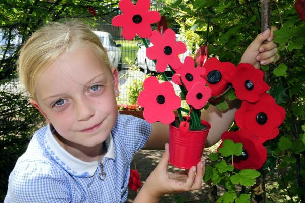 YOUNGSTERS at Unsworth Primary School marked the World War One centenary by creating their own poppy garden. Katie Martin, aged nine, was on hand to help plant the flowers, which pupils created