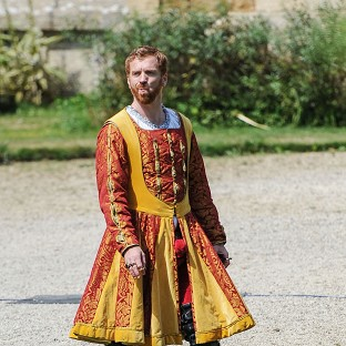 Damian Lewis in the hot and heavy costume of King Henry VIII on the set of Wolf Hall (Rex)