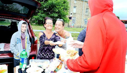 Tyler Reed, 13, Stephanie Reed and Linda Richardson, from Nelson serve food in the car park