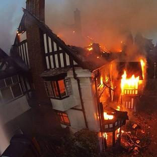 Photo taken with permission from the Twitter feed of @HighgateFire of a fire at Birmingham's Northfield Manor House