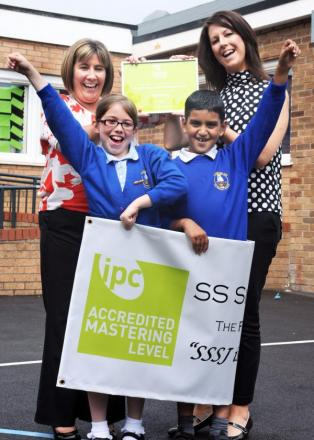 Headteacher Liz Peacock, left, and IPC co-ordinator Jill Ashmore, with pupils Lucy Fleming, aged nine, and Bilal Ahmed, aged seven