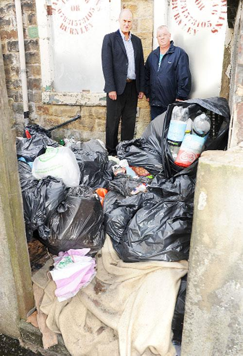 Gordon Birtwistle MP  and local resident Brian Tomlinson show fly tipping in a yard