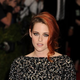 Kristen Stewart doesn't smile for the cameras