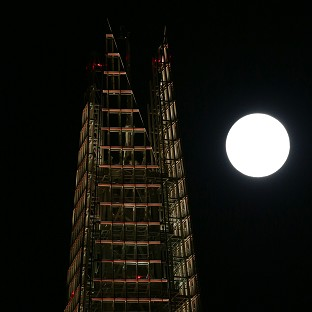 'Supermoon' lights sky amid shower