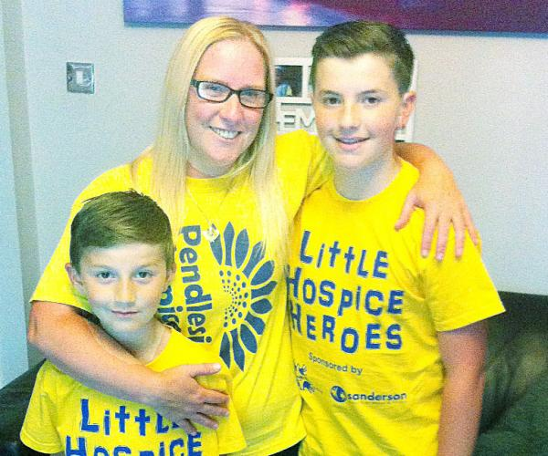 Fundraisers Pharrell and Caine Newman with their  mum Kelly