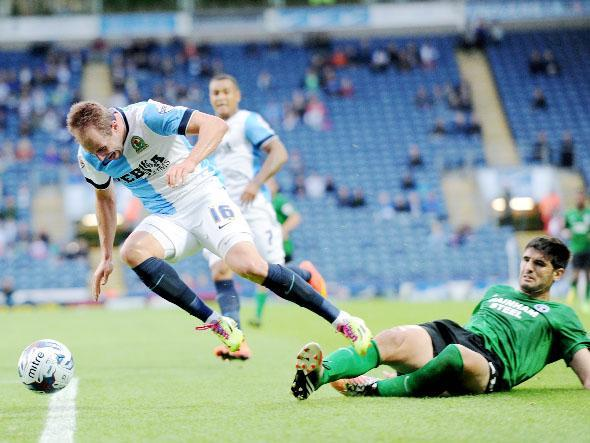 Luke Varney takes a tumble as Rovers crashed out last night