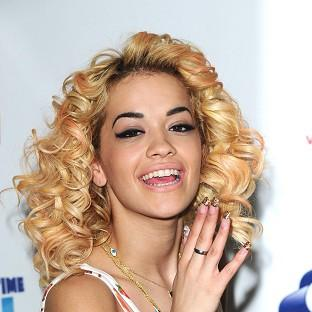 Rita Ora said she has bared all for private photographs