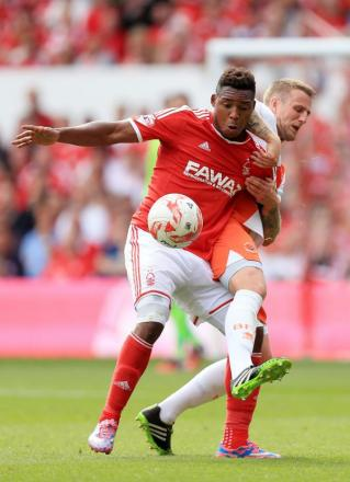 GREAT EXPECTATIONS New Forest striker Britt Assombalonga is under pressure to deliver for his manager, Stuart Pearce, below