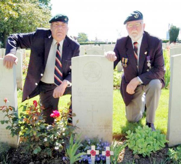 Roy Bailey, right, and colleague Geoff Day at Fred Greenhalgh's grave in La Delivrande