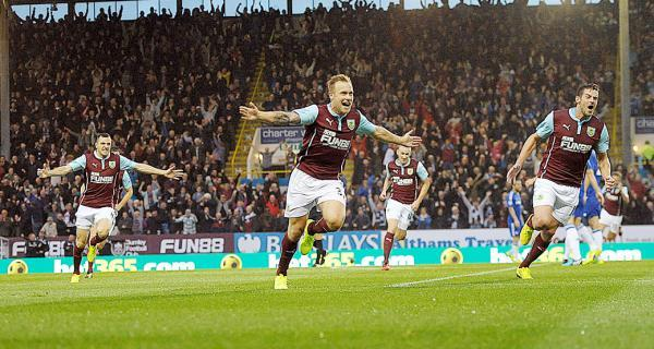 Scott Arfield celebrates putting Burnley ahead against Chelsea