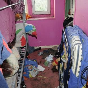 The house of a couple who were jailed for neglecting five of their children. (Gloucestershire Police/PA)