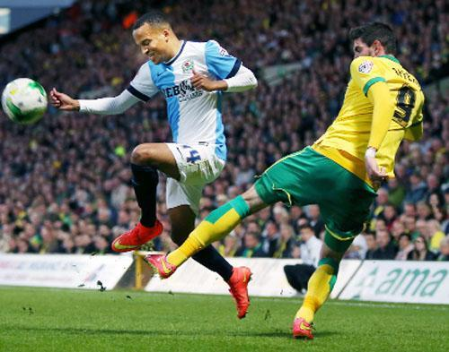 Markus Olsson challenges Norwich's former Burnley striker Kyle Lafferty