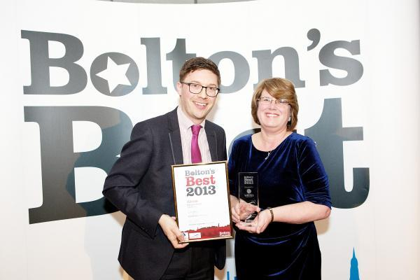 Ann Brown,  Blackrod Library manager, receives the Best Customer Care award last year from Bolton News deputy news editor Steve Thompson