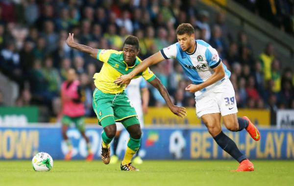 Rovers striker Rudy Gestede battles for possession on Tuesday