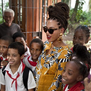 Beyonce poses for photos with school children as she tours Old Havana, Cuba