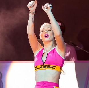 Iggy Azalea fell off the stage during an MTV Video Music Awards benefit concert (AP)