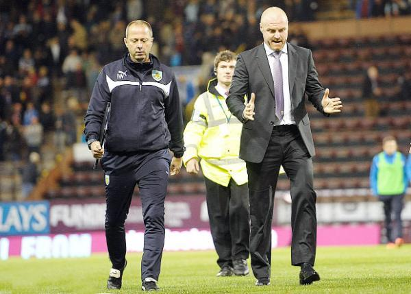 Sean Dyche and his assistant boss Ian Woan (left) rue their cup exit Picture: ANDY FORD