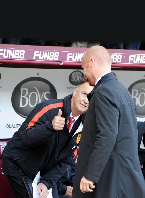 Sean Dyche chats to United boss Lous van Gaal before kick-off at Turf Moor Picture: PHILL HEYWOOD