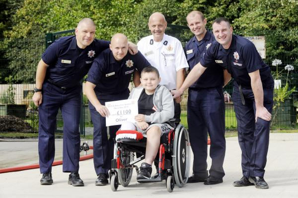 Firefighters give £1,100 to school boy they rescued from horsebox horror accident