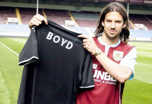 George Boyd shows off his new Clarets strip after signing from Hull