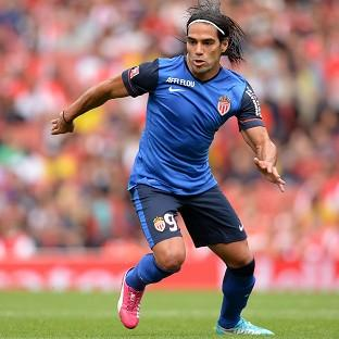 Wayne Rooney is excited by the prospect of playing alongside Radamel Falcao.