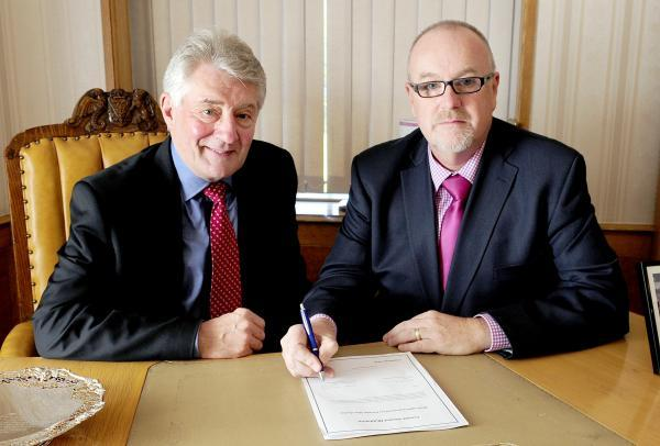 Tony Lloyd, left, and Cllr Mike Connolly launching the scheme to tackle female genital mutilation (FGM).