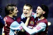 Jay Rodriguez is congratulated by Graham Alexander and Chris Eagles after scoring against Tottenham in 2009