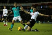 Jason Lowe is tackled in Rovers' defeat to Derby