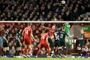PUNCH: Burnley goalkeeper Tom Heaton clears the Clarets lines during their defeat to Liverpool at Anfield last night