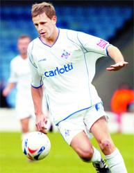YOUNG GUN: Chris Porter in action for Oldham