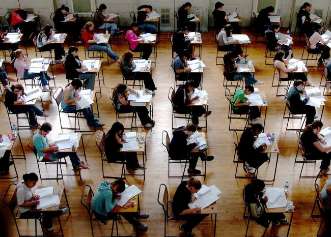 Library filer dated 10/06/2005 of school exams taking place. A-Levels must be made harder to stretch the brightest pupils, the head of the Government's exams watchdog said Wednesday March 29, 2006. Ken Boston, chief executive of the Qualifications and