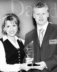 PROUD: David receives his award from Natasha Kaplinsky