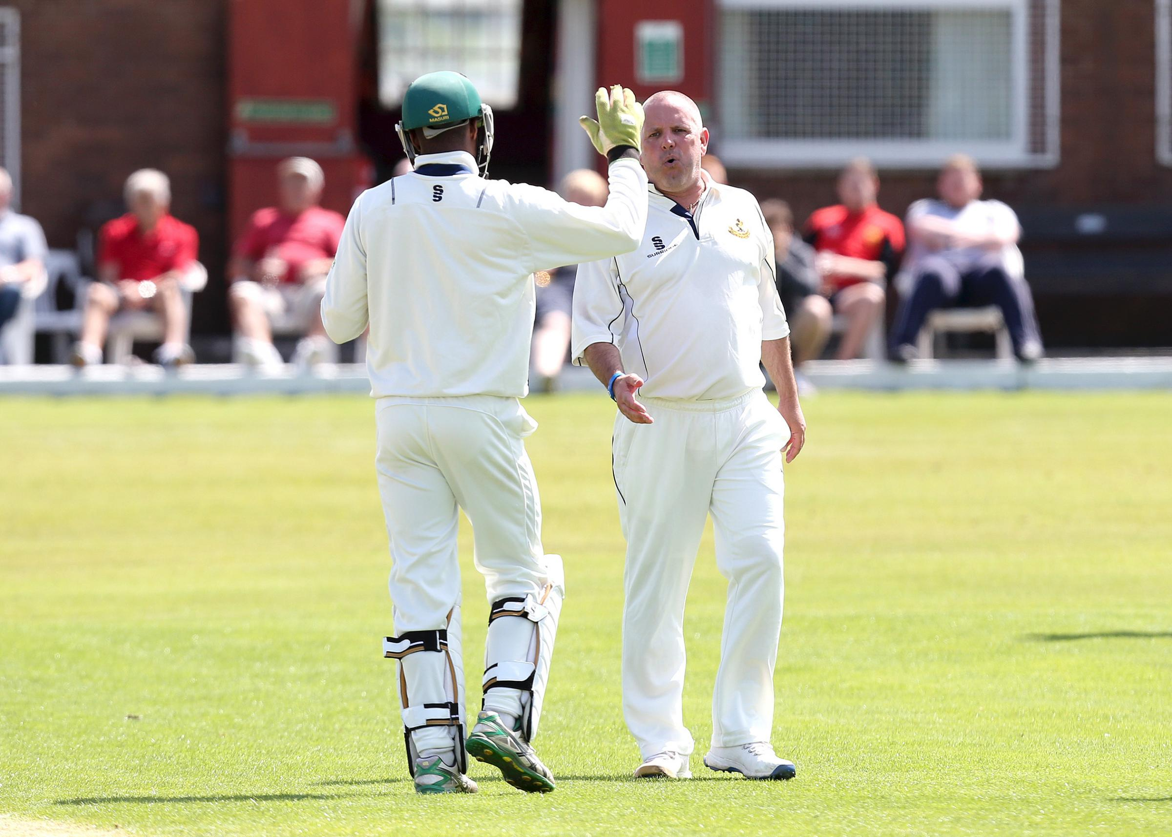 Ribblesdale Wanderers Ian Britcliffe celebrates the wicket of Baxenden's Gary Sudworth