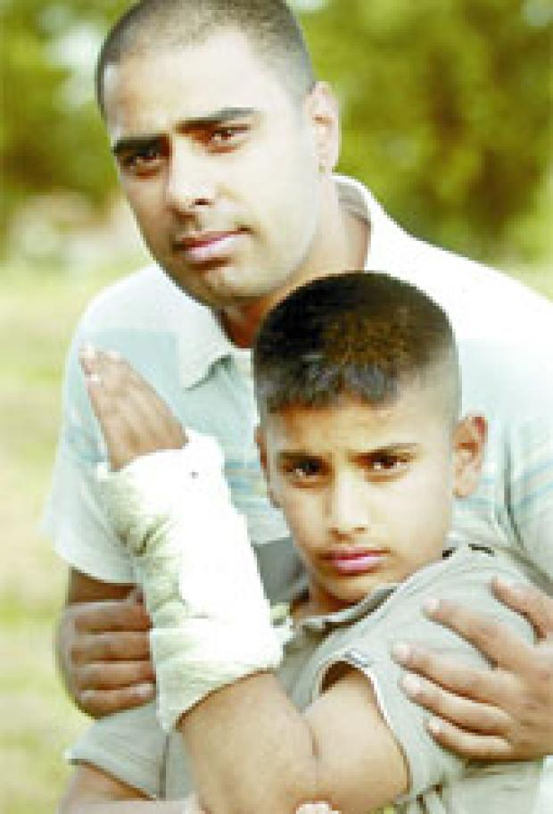 BACK HOME: Hassan Mahmood and his dad Wajid