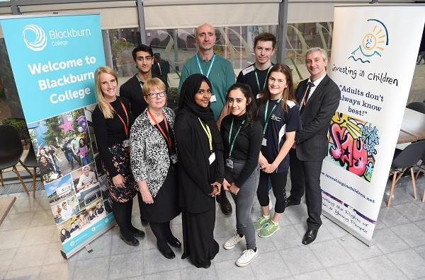 Blackburn College staff and students celebrate the Investing in Children Award