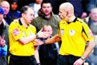 Howard Webb and assistant Darren Cann decide to give the goal