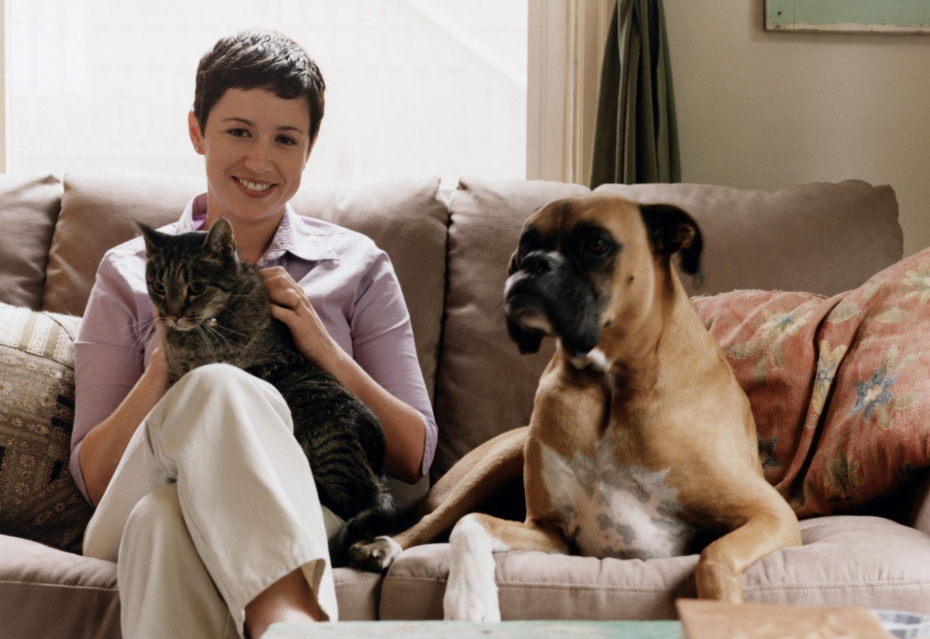 A list of the top 10 names for pets has been revealed. A Generic Photo of a woman with her pet cat and dog. See PA Feature HEALTH Pets. Picture credit should read: PA Photo/Thinkstockphotos. WARNING: This picture must only be used to accompany PA Feature