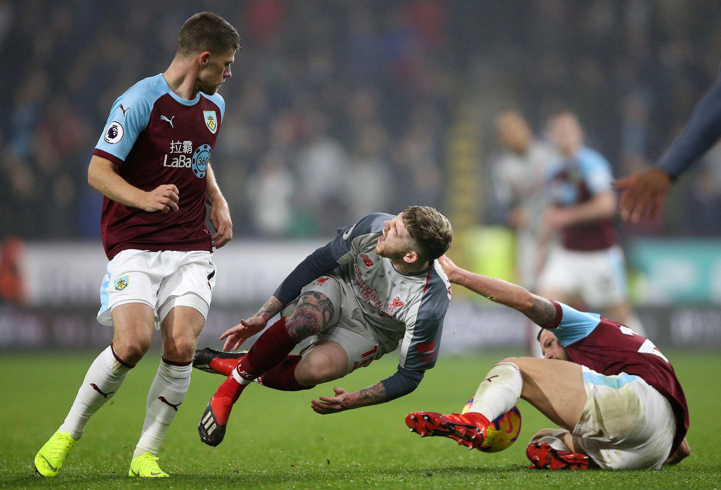 Liverpool's Alberto Moreno (centre) reacts to a challenge during the Premier League match at Turf Moor, Burnley. PRESS ASSOCIATION Photo. Picture date: Wednesday December 5, 2018. See PA story SOCCER Burnley. Photo credit should read: Nigel French/PA