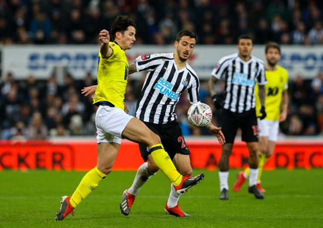 Lewis Travis battles for possession with Newcastle United striker Joselu