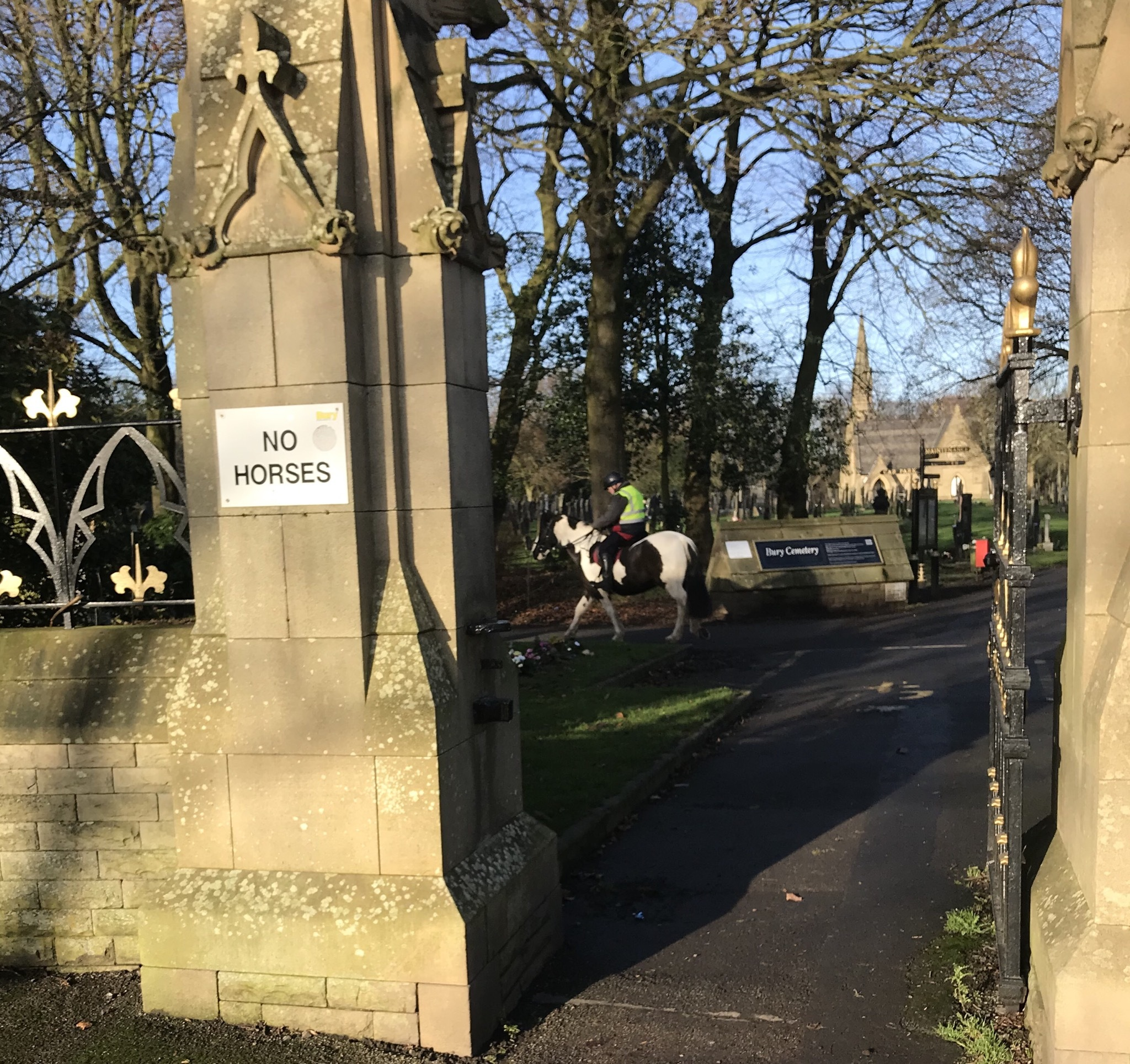 Horse rider ignores sign at Bury cemetery