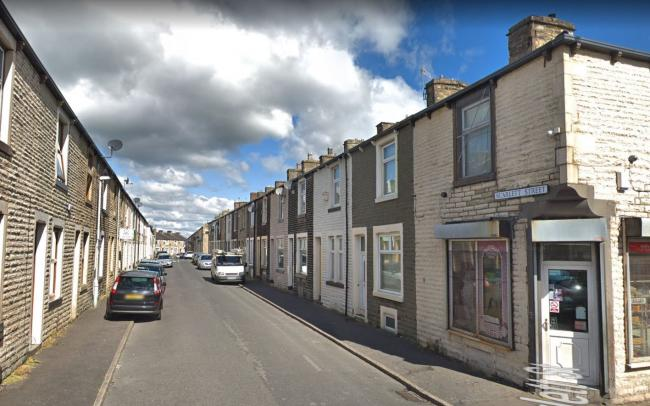 The man's body was found in a house on Scarlett Street in Burnley.