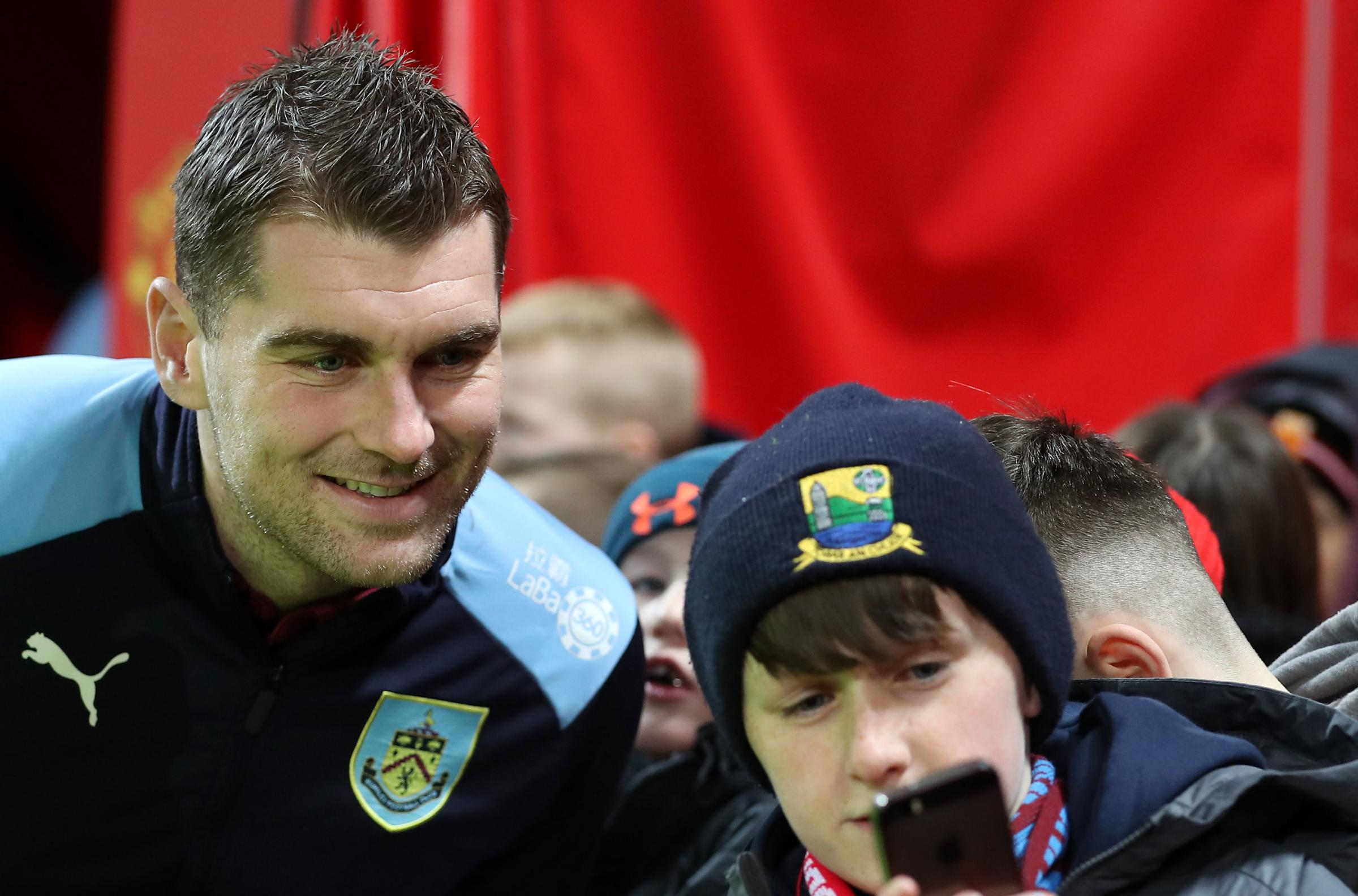Burnley's Sam Vokes interacts with a fan during the Premier League match at Old Trafford, Manchester. PRESS ASSOCIATION Photo. Picture date: Tuesday January 29, 2019. See PA story SOCCER Man Utd. Photo credit should read: Martin Rickett/PA Wire. RESTR