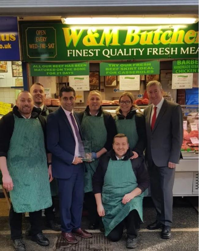 Markets manger Andrew Heyes and council leader Rishi Shori with the Britain's Favourite Market trophy, along with the traders from W&M Butchers, one of the stalls that had a 'secret shopper' visit which formed part of the award judgi