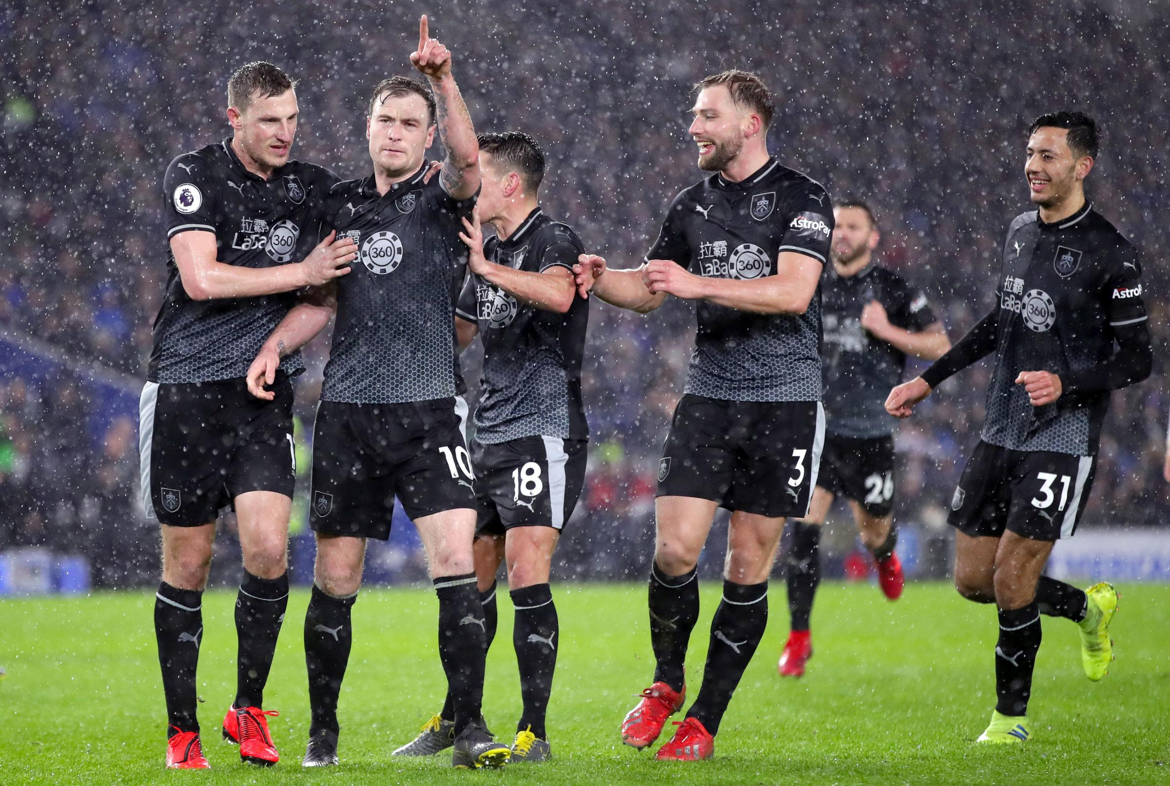 Burnley's Ashley Barnes (second left) celebrates scoring his side's third goal of the game from the penalty spot with team mates during the Premier League match at the AMEX Stadium, Brighton. PRESS ASSOCIATION Photo. Picture date: Saturday Februa