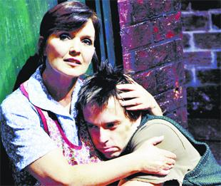 ON STAGE: Maureen Nolan and Sean Jones in a scene from Blood Brothers