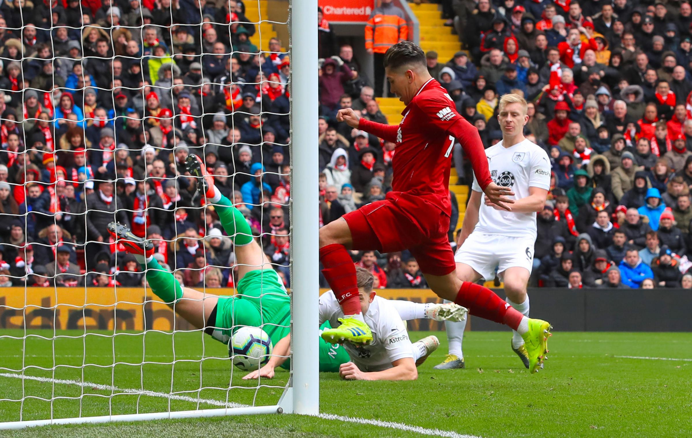 Liverpool's Roberto Firmino scores his side's first goal of the game during the Premier League match at Anfield, Liverpool. PRESS ASSOCIATION Photo. Picture date: Sunday March 10, 2019. See PA story SOCCER Liverpool. Photo credit should read: Pet