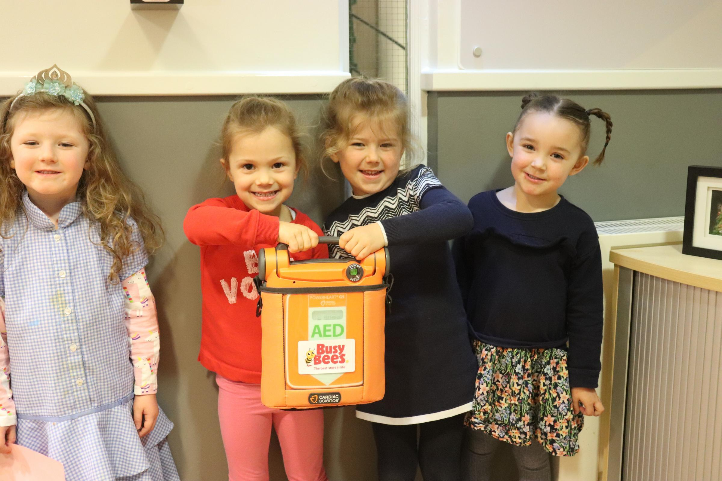 SAFETY: Children at Busy Bees with the defibrillator