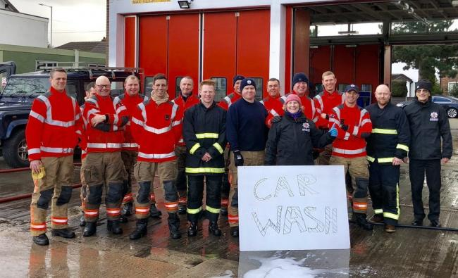 Firefighters from Bolton Central and Agecroft Station celebrate after a community car wash