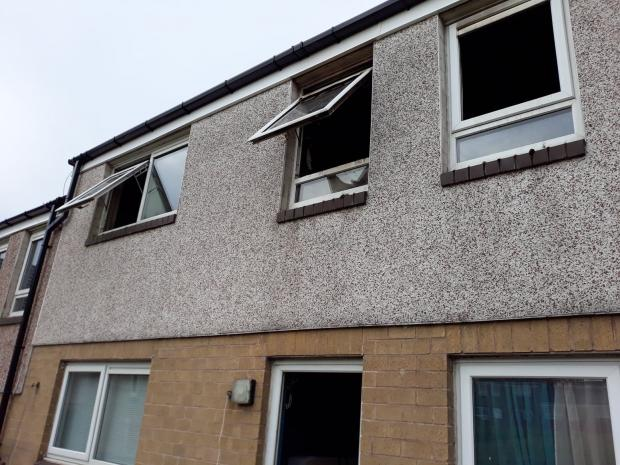 This Is Lancashire: Windows at the rear remained blackened and broken