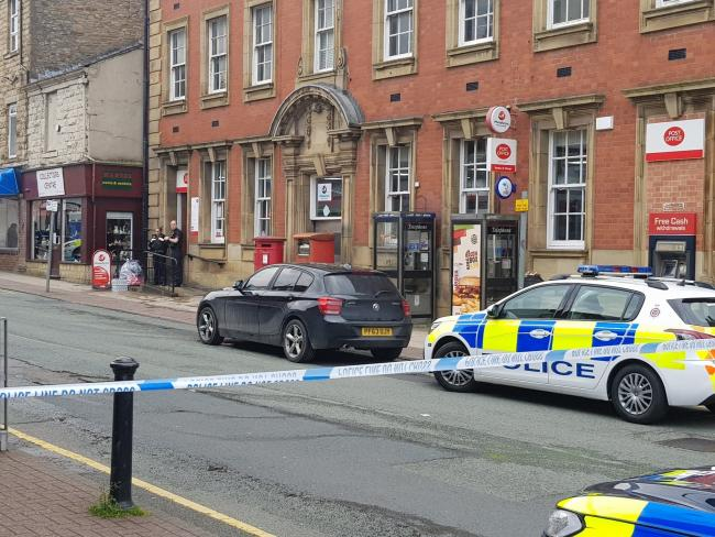 Police at the scene of a post office robbery in Abbey Street in Accrington.
